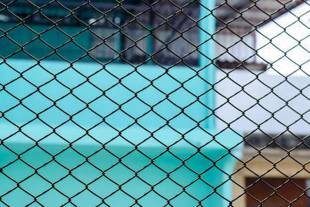 poky: Metallic or chain link fence around the building