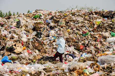 landfill site: KANCHANABURI PROVINCE, THAILAND-MARCH 17: Worker working in open dump site.  Illegal landfill site  at Kanchanaburi Province on MARCH 17 , 2016 in KANCHANABURI  PROVINCE THAILAND