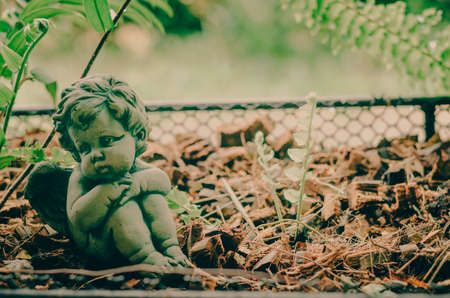 an entertainer: Little angle look like lonely in the garden: soft focus Stock Photo