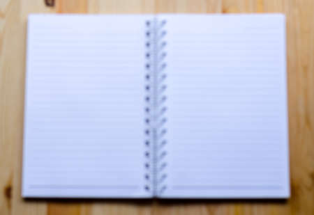 spiral binding: picture of note book paper on wooden background