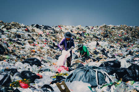 waste disposal: MUKDAHAN PROVINCE, THAILAND-MARCH 1: People workung in Municipal waste disposal open dump process. Cinematic tone filter