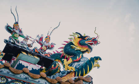 festival scales: Dragon statue in Chinese temple, cinematic tone filter