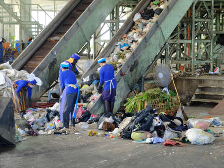 pile reuse engine: LAMPANGPROVINCE, THAILAND-DECEMBER 7 2016, Women in sepate line collect the plastic and metallic waste from household in waste disposal factory. Recyclable waste in dump site