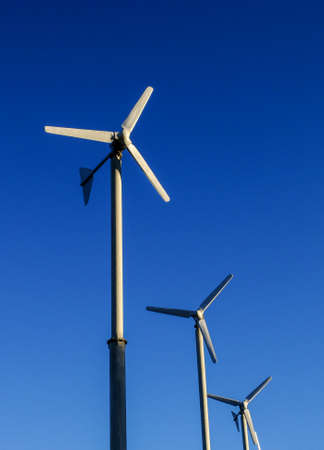 Windmill over the blue sky, energy from sustain resource.