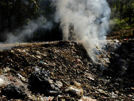 pile reuse engine: MAEHONGSON PROVINCE, THAILAND-DECEMBER 23 2016, Waste from household in waste landfill. Waste burning in dumping site in THAILAND