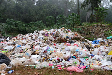 pile reuse engine: MAEHONGSON PROVINCE, THAILAND-DECEMBER 21 2016, Waste from household in waste landfill. Waste burning in dumping site in THAILAND Stock Photo