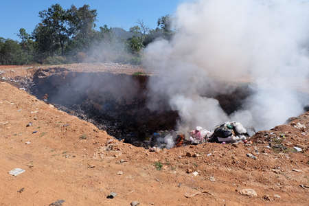 pile reuse engine: MAEHONGSON PROVINCE, THAILAND-DECEMBER 20 2016, Waste from household in waste landfill. Waste burning in dumping site in THAILAND