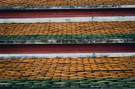 background texture: Old ceramic roof top in Thai temple, vintage tone picture Stock Photo