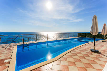 Seaview swimming pool in a modern mediterranian villa. without  people. Stock Photo