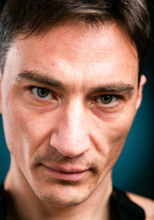 Close up vertical studio headshot portrait of young caucasian man stand look at camera posing, feel positive optimistic