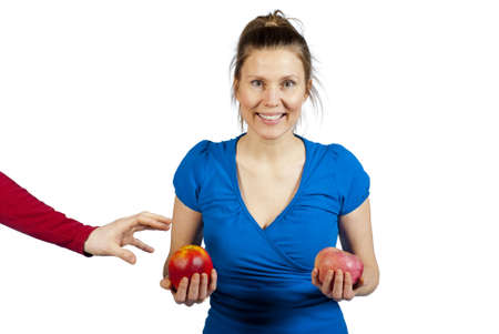 unsuspecting: A smiling woman holding her two apples, unsuspecting of a man trying to steal one.