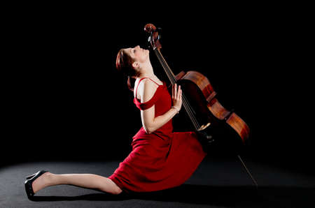 Sexy concept of a young woman dancing the tango wit a cello photo