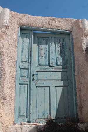 mediterraneo:  old blue door in the sun ,grecia,mediterraneo  Stock Photo