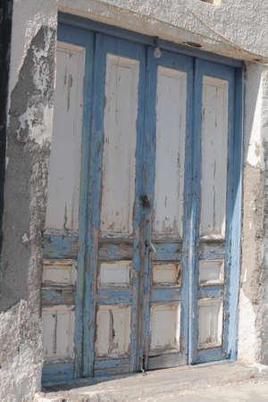 mediterraneo: old door white and blue abandoned,grecia,mediterraneo