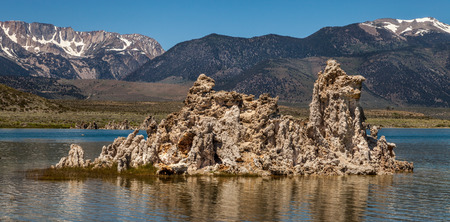 Calcium formation at Mono Lake in the middle of the water with the mountain on background Stock fotó