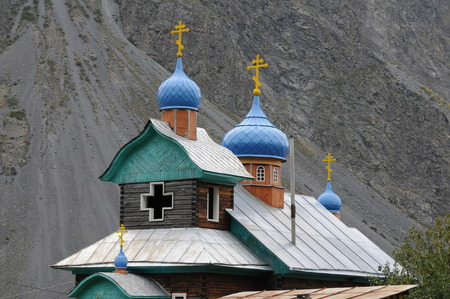 cross of the church among the big mountains of mongolia