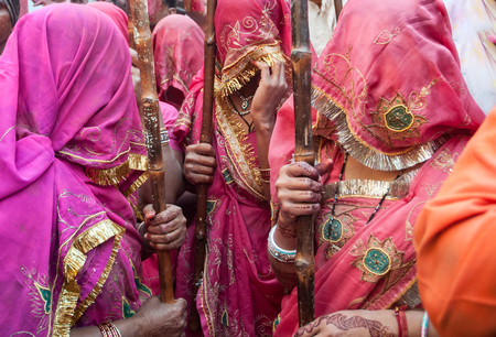 Colorful sari traditional women outfit in India during the Lathmar Holi Festival were woman chase men in Barsa and Mathura with sticks