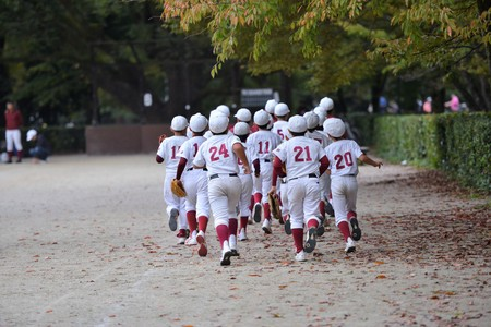Japanese kids training in the park at their baseball club after school