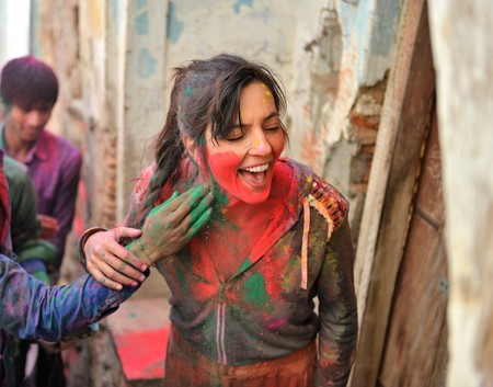 Holi festival in Barsa and Mathura India is an adventure when people throw on each other colored powder
