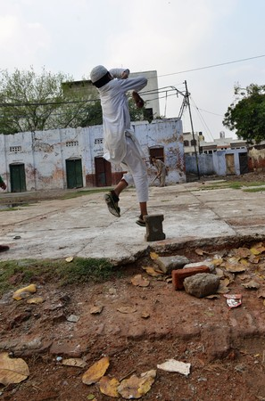 Muslim boys play cricket in a park in new delhi india