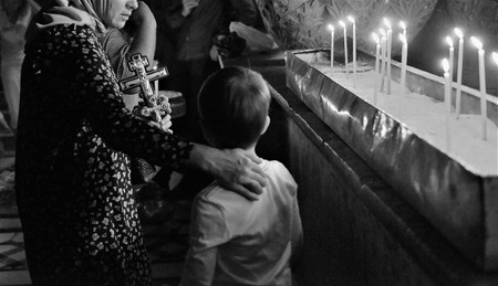 Religious pilgrims come from all over the world to Jerusalem during christmas and eastern, and follow the via dolorosa path that jesus christ  walked before crucifix