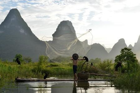Cormorant fishermen in China