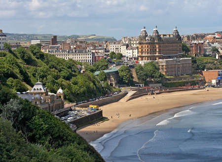 Scarborough is an English town by the sea, popular in Summertime for holidays.