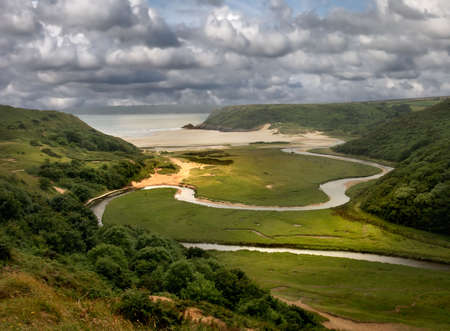 Three Cliff Bay on the Gower Peninsula, South Wales, UK, is a renowned beauty spot.