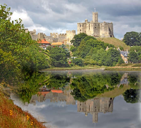 The 12th century Warkworth Castle in Northumbria, England. Stock Photo