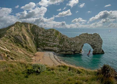durdle door: Durdle Door, a limestone arch on the Dorset coast in England.