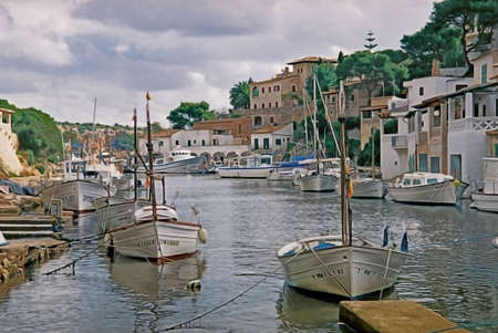 The sea inlet at Cala Figuera in Mallorca, Spain, provides a perfect harbour for small boats.