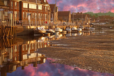 Late evening Summer sun shines on the harbour at Blakeney in Norfolk, England. Stock Photo