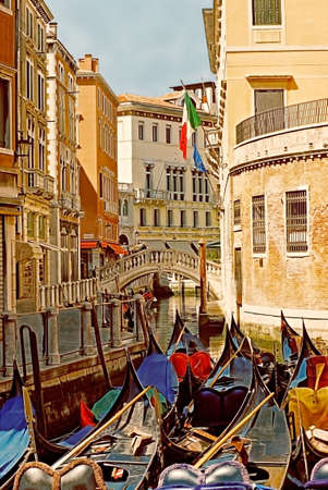 Unused gondolas ready for the tourists in the heart of Venice, Italy. photo