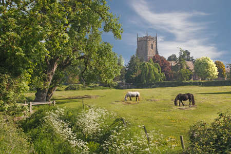 The church at Frampton on Severn in Gloucestershire, England, is situated at the edge of the village. Stock Photo