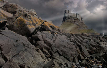 Storm clouds over Lindesfarne castle on Holy Island in Nortumberland, England. Stock Photo
