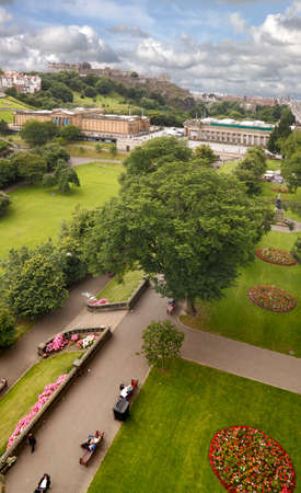 arial: The gardens alongside Princes Street in Edinburgh, Scotland, with the National Gallery beyond and the castle on the skyline.