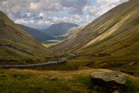 The Kirkstone Pass descends steeply towards Brothers Water in the Lake District in Cumbria, England.