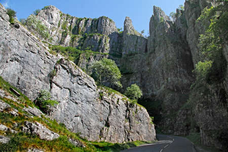 The cliffs of Cheddar Gorge in the Mendip Hills in Somerset, England are limestone and around 500 feet high. Stock Photo