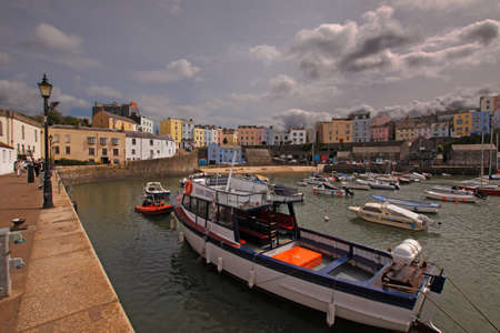 tenby wales: Tenby is a holiday resort in South Wales and the harbour is home to pleasure and trip boats. Editorial