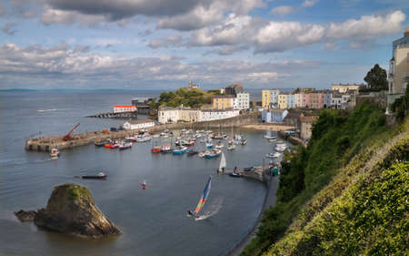 tenby wales: The harbour and sea front at Tenby in Wales lie well below the town.