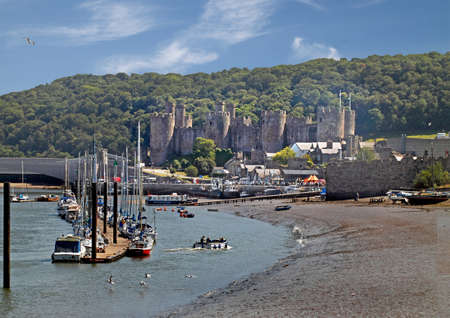 moorings: Conwy estuary harbour and 13th century castle in Wales UK. Stock Photo