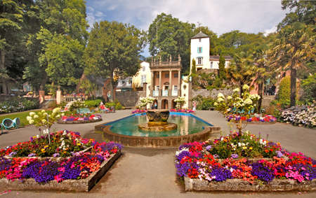 The centre of Portmeirion village has an attractive square with colourful flower beds. Stock Photo