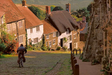 Gold hill in Shaftesbury has a very attractive appearance, with its many quaint old cottages. Stock Photo
