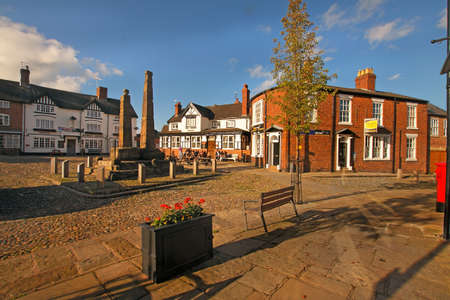 ninth: Two ninth century Anglo-Saxon crosses stand in the market square at Sandbach in Cheshire, England  Editorial
