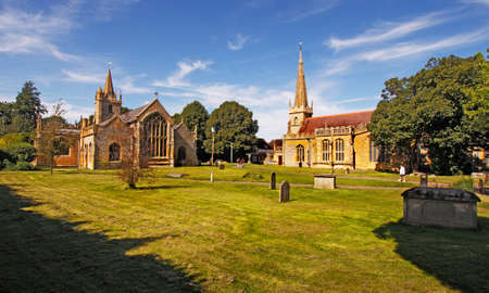 worcestershire: St Lawrences church and All Saints church stand close together in the town of Evesham in Worcestershire, England. Stock Photo