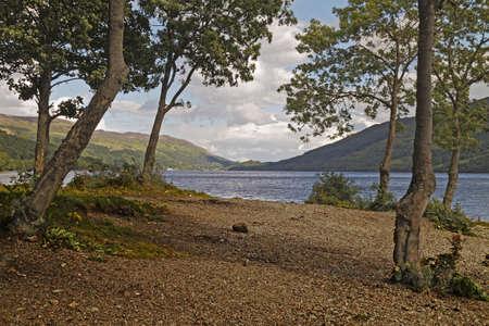 lochs: Loch Earn is one of many beautiful fresh water lochs in Scotland. Stock Photo