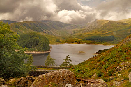 Haweswater reservoir was enlarged by the building of a dam early in the twentieth century, causing several farms and a village to be submerged. Stock Photo - 22223377