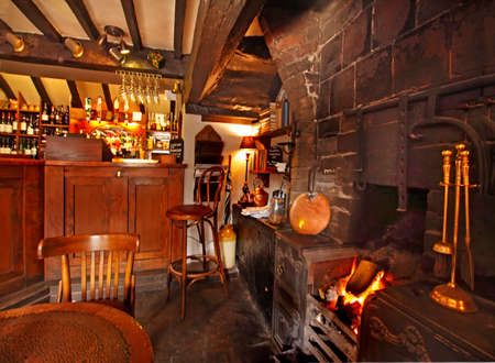 public houses: In the winter time a log fire is often to be seen in old fashioned English Public Houses and Inns  Editorial