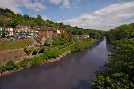 severn: A view of the river Severn, looking downstream with the town of Ironbridge, the birthplace of the industrial revolution on the left