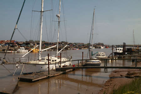 southwold: The river Blyth in Suffolk, England is situated in between Southwold and Walberswick and is popular with boating people  Stock Photo